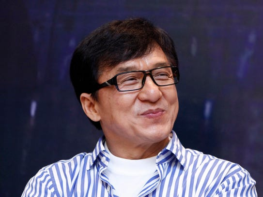 Jackie Chan smiles during a news conference to promote