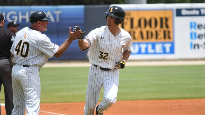 Southern Miss' Matt Wallner is congratulated by coach Scott Berry after he hit a 2-run home run in the first inning of Sunday's Conference USA tournament championship game against FAU.