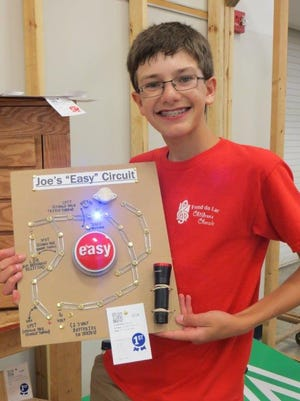 Joseph Krahn holds one of his 4-H projects.