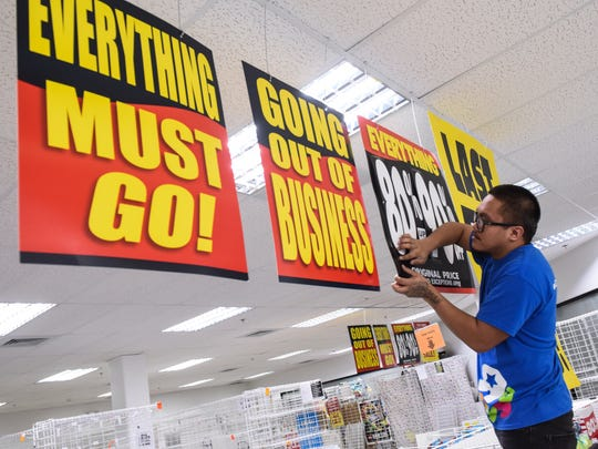Sales associate Richard Blas increases the markdown percentage on a sign posted at the Toys R Us Express store at the Micronesia Mall in Dededo. Wednesday will be the last day of operation for the toy store, said Store Manager Tim Zedicher. Zedicher did indicate that the closing of the franchise's local store was not a reflection of the Guam market, but more a decision made by the national corporate office.