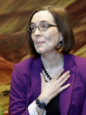 Oregon Secretary of State Kate Brown listens to comments from speakers during a celebration at the Oregon Historical Society to mark the 156th anniversary of Oregon's admission to the union as the 33rd state in Portland, Ore., Saturday, Feb. 14, 2015.  Brown will become Oregon's governor next week on the heels of the resignation of Oregon Gov. John Kitzhaber.