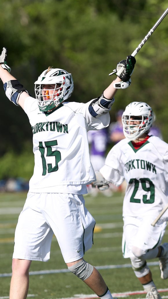 Yorktown's Kyle Casey (15) celebrates his first half goal with teammate Shane Dahlke (29) during the boys lacrosse Section 1 Class B championship game at Mahopac High School May 26, 2017. Yorktown won the game 14-6.