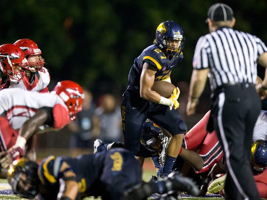 Naples' Chez Mellusi carries the ball in the fourth
