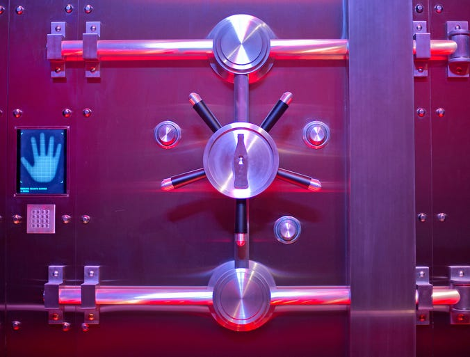 The vault containing the secret recipe for Coca-Cola is displayed at the World of Coca-Cola museum on Aug. 9 in Atlanta. The 127-year-old recipe for Coke sits inside an imposing steel vault bathed in red security lights while security cameras monitor the area to make sure the fizzy formula stays a secret.