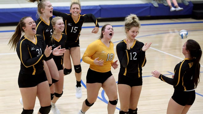 Haven celebrates its 25-21, 25-22 win over Pretty Prairie on Tuesday evening at the Pretty Prairie triangular.