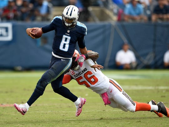 Titans quarterback Marcus Mariota (8) gets away from