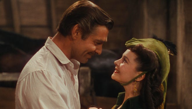 Clark Gable as Rhett Butler, and Vivien Leigh as Scarlett O'Hara in 'Gone With the Wind.'