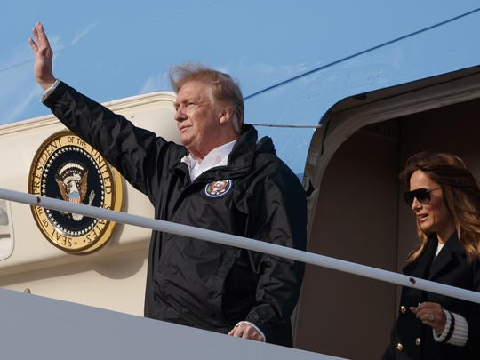 this Friday, March 8, 2019 file photo, president Donald Trump and first lady Melania Trump arrive on Air Force One at Palm Beach International Airport, in West Palm Beach, Fla., en route to his Mar-a-Lago property in Palm Beach, Fla.
