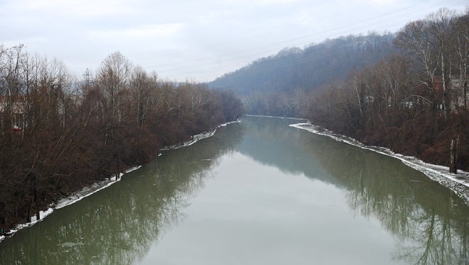 A chemical spill into the Elk River in Charleston, W. Va. prompted the governor to warn at least 300,000 people not to bathe, brush their teeth, wash their clothes on drink water from the tap. The West Virginia National Guard planned to distribute bottled drinking water to emergency services agencies in the nine affected counties.