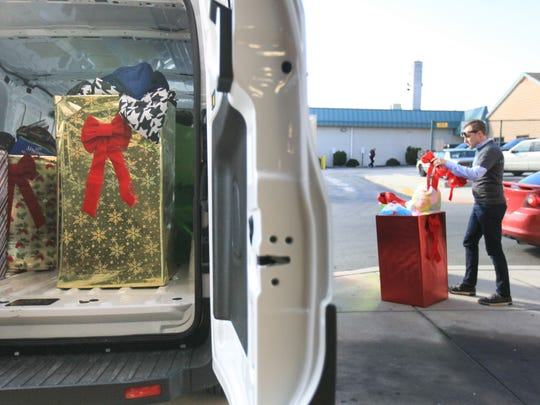 Jason Lewis, from AmeriHealth Caritas, delivers toys to the Police Athletic League of Wilmington Thursday.