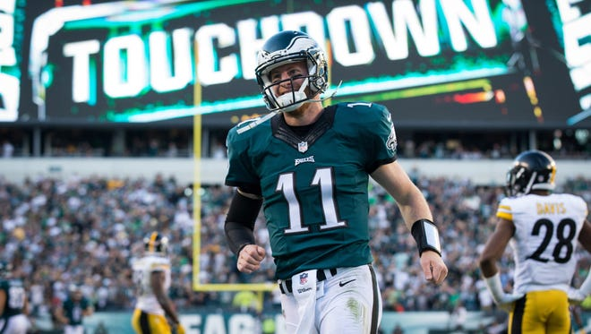 Philadelphia Eagles quarterback Carson Wentz (11) reacts after his 73 yard touchdown pass against the Pittsburgh Steelers during the third quarter at Lincoln Financial Field.