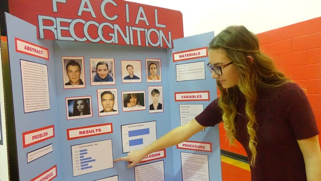 Makyla Ferris, an 8th-grade Bucyrus student, points out the results of her project Wednesday at the Bucyrus Science Fair. Ferris earned a superior for her project, sending her to the district science fair in Marion.