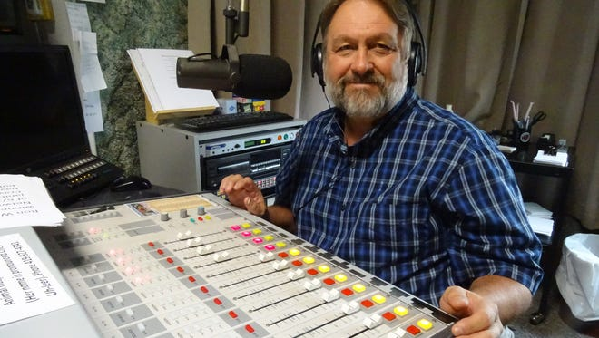 Gary Ogle sits in the Q92.7 studio Monday. He's retiring this week after 21 years in the local media industry.