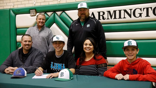 Farmington High School pitcher Jac Cordova signs his National Letter of Intent on Friday to play baseball at Luna Community College.
