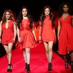 In this Thursday, photo released by Starpix, members of Fifth Harmony, from left, Dinah Jane Hansen, Ally Brooke, Lauren Jauregui, Camila Cabello and Normani Hamilton walk the runway at the Go Red for Women Red Dress Fashion Show at Lincoln Center in New York.