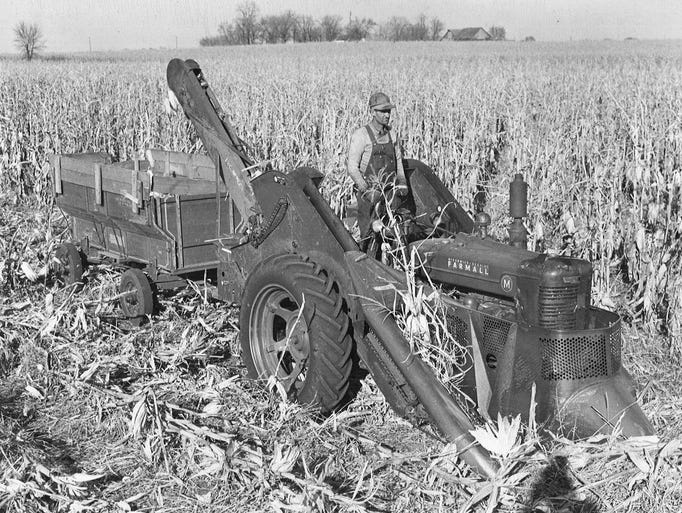 Clarence Gibbons of Polk City operates a two-row mounted corn picker on the Morris Alleman farm near Sheldahl. Gibbons planned to pick 600 to 700 acres of corn in 1943.