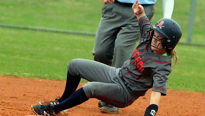 Beech High sophomore Natalie Lankster slides into second base during a stolen-base attempt during second-inning action. Lankster scored five runs in the Lady Buccaneers' 22-11 victory over visiting Station Camp.