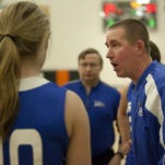 Cros-Lex head coach Darren Bongard talks with players in a time out during a basketball game Friday, Feb. 20, 2015 at Armada High School.