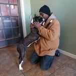 Bernard Holland visits his dog, Oreo, at Wigglebutt Doghouse.