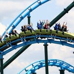 Patrons ride the Lightning Run roller coaster at Kentucky Kingdom in Louisville.