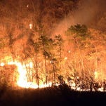 A stubborn forest fire continues to rage out of control in the Shawangunk Ridge State Forest early Tuesday morning May 5, 2015. The fire which started Sunday afternoon in Summitville in Sullivan County has spread east into Ulster County. The fire has consumed hundreds of acres and is being fought by firefighters from over 20 departments in Sullivan, Ulster and Orange counties along with state forest rangers and state police helicopters.