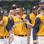 Hartland pitcher Kyle Kletzka is bear-hugged by catcher Max Cadman after the Eagles' semifinal win against Kenowa Hills Thursday. Hartland will go for its first state baseball title Saturday at 9 a.m. against Portage Northern at MSU.