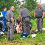 Authorities surround prison escapee David Sweat after he was shot and captured June 28, 2015, near Constable, N.Y.