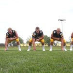 Iowa's Eric Simmons (No. 58, second from right) could be in a position for a breakthrough season with the Hawkeyes.