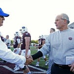 Missouri State coach Dave Steckel (right) and Indiana State coach Mike Sanford after Saturday's game.