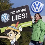 Volkswagen has said up to 11 million vehicles worldwide across several of its brands contain the diesel engine with the software used to cheat on U.S. emissions tests, here an activist of the environmental protection organization Greenpeace protests Sept. 25, 2015, in front of a factory gate of the German car manufacturer Volkswagen in Wolfsburg, Germany.