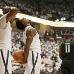 Jalen Reynolds (right), celebrating with James Farr, played a pivotal role in Xavier's 65-55 win over UC in Saturday's Skyline Chili Crosstown Shootout. Reynolds scored eight points with a team-high-tying six rebounds in 18 minutes.