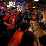 Fans cheer during Super Bowl 50 on Sunday evening at Road 34 in Fort Collins. Police are pleased that the city was mostly peaceful in celebrating the Denver Broncos' 24-10 win over the Carolina Panthers.