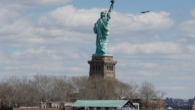 New York Police boats are docked at Liberty Island where the Statue of Liberty was evacuated with officers responding to a report of a suspicious package seen from Jersey City, N.J., Friday, April 24, 2015.