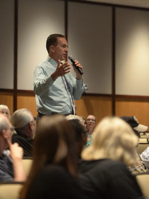 Craig Kinyon of Reid Health speaks from the audience during Thursday's town hall meeting about Wayne County's addiction problem.