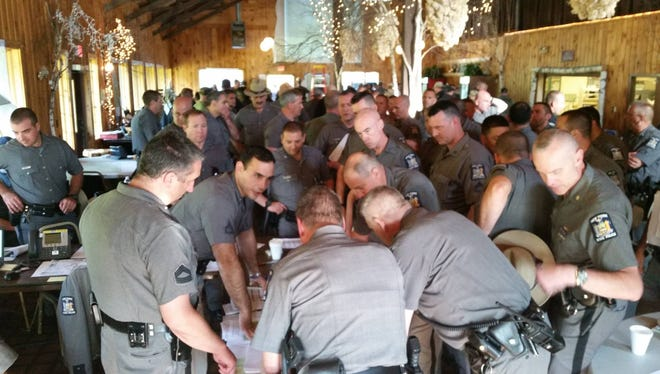 New York State Police hold a morning strategy meeting at the Titus Mountain Ski Area in Malone, N.Y.,  on June 27, 2015, as search efforts continue for prison escapee David Sweat.
