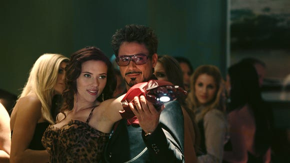 "Black Widow (Scarlett Johansson) and Tony Stark (Robert Downey Jr.) get flirty in ""Iron Man 2."""