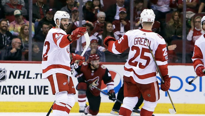 Detroit Red Wings right wing Martin Frk celebrates with Mike Green (25) after scoring a goal iduring the second period of an NHL hockey game against the Arizona Coyotes, Thursday, Oct. 12, 2017, in Glendale, Ariz. (AP Photo/Rick Scuteri)