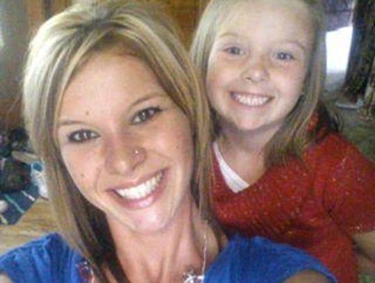 Homicide victim Heather Bogle and her daughter McKenzie.