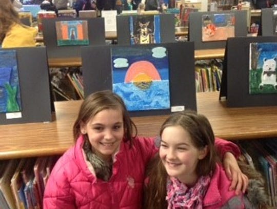Artists Amber F. and Lillie S., attend Maine Elementary