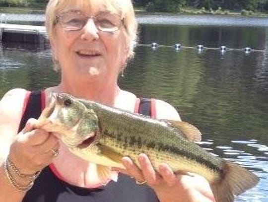 Marilyn Utz holds a striped bass