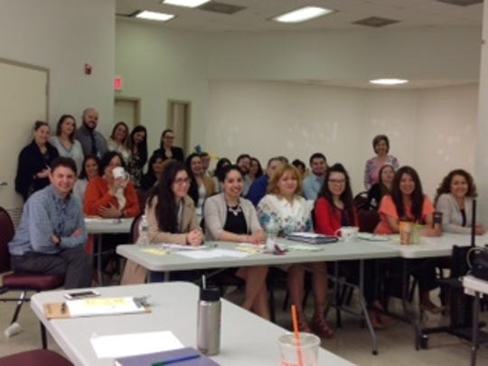 Social workers in Perth Amboy recently received Suicide Intervention and Skills Awareness Training from the crisis hotline Caring Contact.