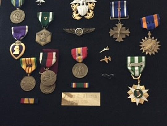 A collection of medals awarded to Navy Cmdr. Ellis