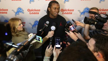 Detroit defensive lineman Ziggy Ansah talks with reporters at the Lions training facility in Allen Park.