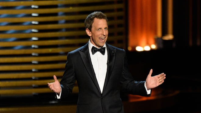 Seth Meyers opens the 66th annual Emmy Awards at the Nokia Theater.