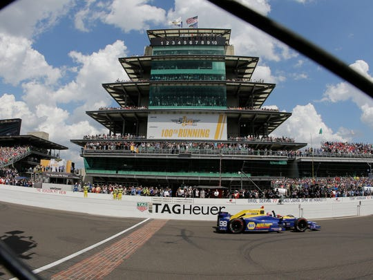 Alexander Rossi crosses the finish line to win the