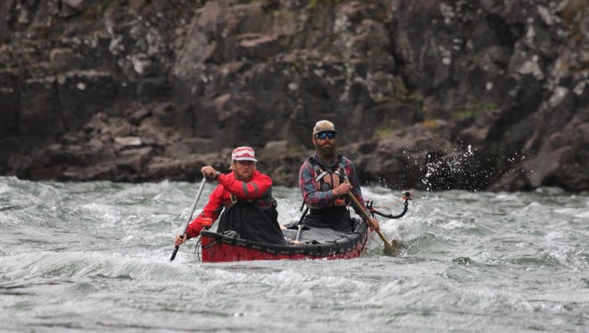 """Jarrad Moore, front, and Winchell Delano paddle the Rocky Defile rapids on the Coppermine River in Canada's Northwest Territories in August 2015 during the 5,200-mile """"Rediscovering North America"""" expedition."""