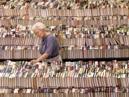 Marian Luke checked out the novel section at the annual