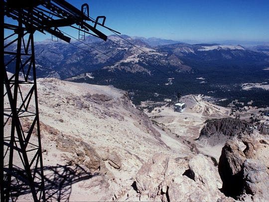 Looking northeast from the summit of Mammoth Mountain of the Mono Craters chain with Mono Lake in far background, upper right. . The Long Valley caldera is in the forested area in the center and right of photo.
