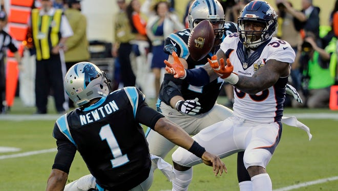 """FILE - In this Feb. 7, 2016, file photo, Denver Broncos' Von Miller (58) strips the ball from Carolina Panthers' Cam Newton (1) during the first half of the NFL Super Bowl 50 football game, in Santa Clara, Calif. Von Miller got the best of Cam Newton both in the Super Bowl and its aftermath, making the NFL's MVP the butt of his jokes on """"SNL"""" and trolling him on Instagram after sack-stripping him twice in the shadow of the Panthers' goal line. Miller, who was named Super Bowl MVP after his two sack-strips of Newton led to both of Denver's touchdowns in the Broncos' 24-10 win seven months ago, said he lobbed the friendly jabs only because he has immense respect for Newton, whom he called """"the best player in the league."""" Newton, who faces Miller again Thursday night in the 2016 NFL kickoff in Denver, swears he didn't mind Miller rubbing it in."""