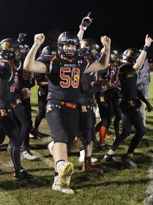 Cedar Grove-Belgium's Justin Rose (58) reacts to his team's 28-0 victory over Valders, Friday, November 3, 2017, at Cedar Grove, Wis.
